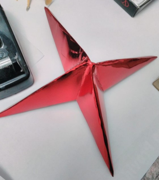 3. You should fold the cardboard from the cut areas for the last time and glue the overlapping folds together.