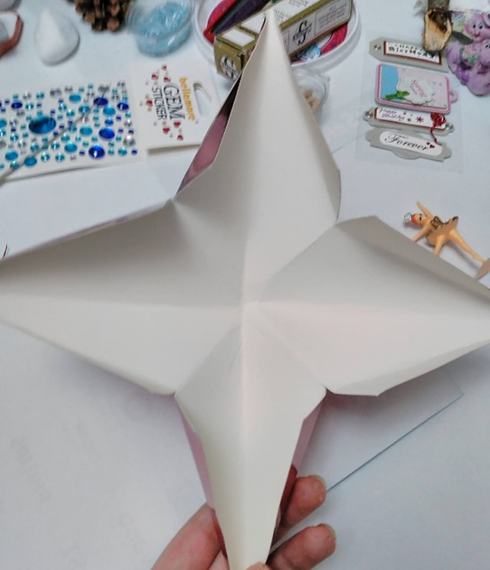 1. First of all, you have to cut the cardboard in a square shape and fold it by matching the corners and edges.